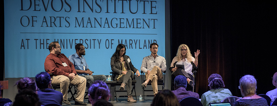 five people speak on a panel