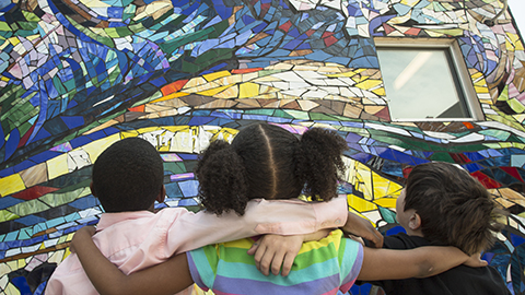 children looking at mural